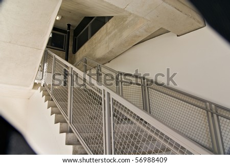 A stairway in a very busy downtown parking garage. - stock photo