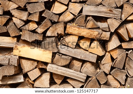 A staple of biomass, arranged firewood. - stock photo