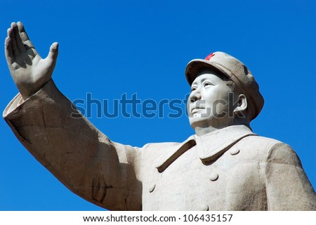 A Statue of China's former Chairman Mao Zedong in the city of Kashgar, China - stock photo