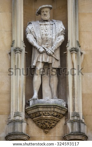 A statue of King Henry VII on the exterior of Kings College in Cambridge, UK. - stock photo
