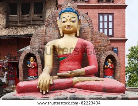 a statue of sitting Buddha in Swayambhunath - Kathmandu, Nepal - stock photo
