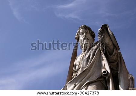 A statue of St. Paul backed by blue sky, Vatican City, Rome. - stock photo