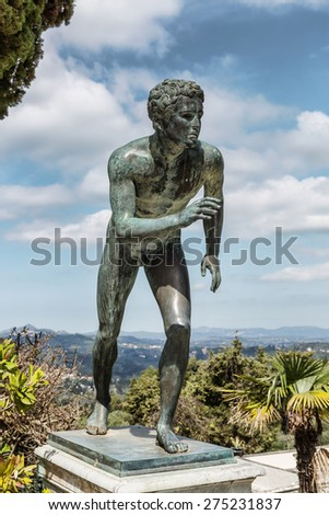 A statue of 'The Runner' in the garden of Achilleion in Corfu palace - stock photo