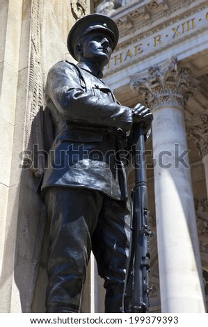 A statue on the City of London War Memorial situated outside the Royal Exchange in London. - stock photo