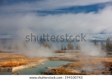 A steamy geyser at Yellowstone National Park, Wyoming, USA - stock photo