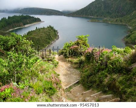 A steep path leading to the lake Lagoa do Fogo, Sao Miguel, Azores - stock photo