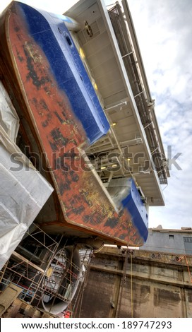 A stern (back) of an offshore vessel in yard - stock photo