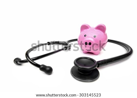 a stethoscope with pink piggy bank - stock photo