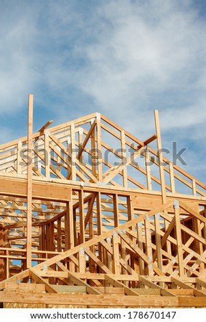 A stick built house under construction - stock photo