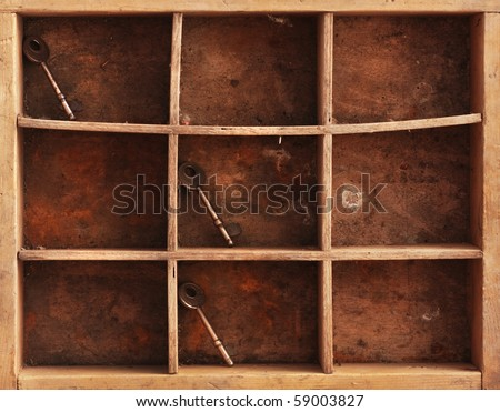 a still life composition with old dusty shelves with three keys and a rusty chain - stock photo