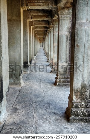 A stone hallway that is part of the Angkor Wat temple complex near Siem Reap Cambodia. - stock photo