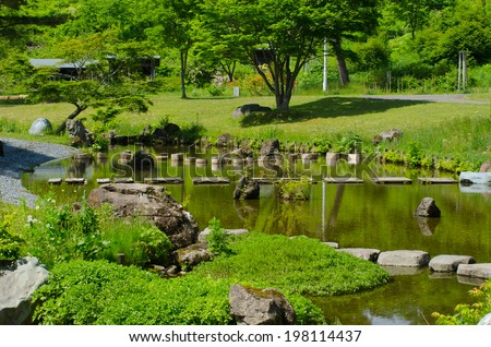 A stone path in the japanese lake in garden  - stock photo
