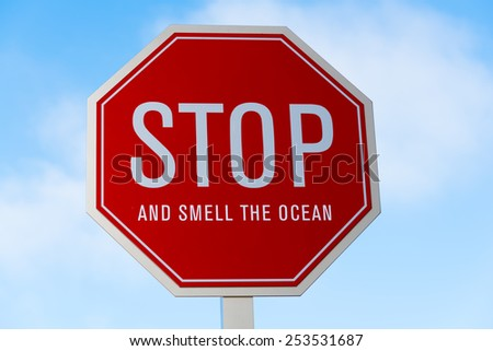 """A """"stop and smell the ocean"""" traffic, street sign in southern California - stock photo"""