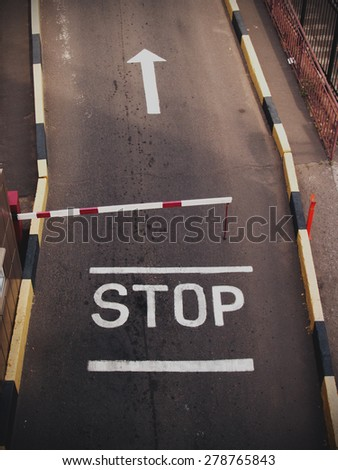 a stop sign painted on the road - stock photo