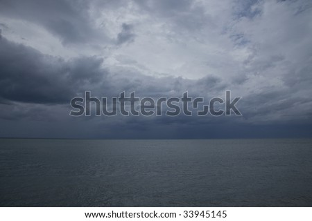 a storm brewing out at sea - stock photo