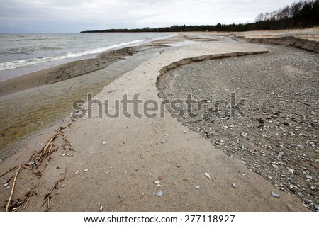 A stream has changed course; dry old stream bed at right. Photographed at at the Baltic Sea, North coast of Estonia.  - stock photo