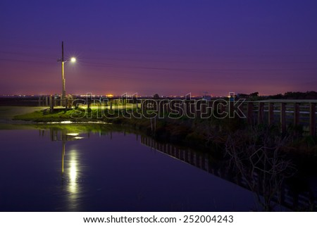 A Street Lamp at Night in a Park - stock photo