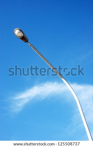 a street light pole with a blue sky background - stock photo