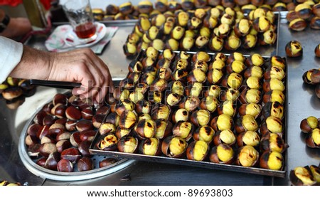 A street vendor sells freshly roasted chestnuts in Istanbul - stock photo