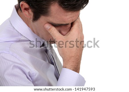 A stressed out businessman - stock photo
