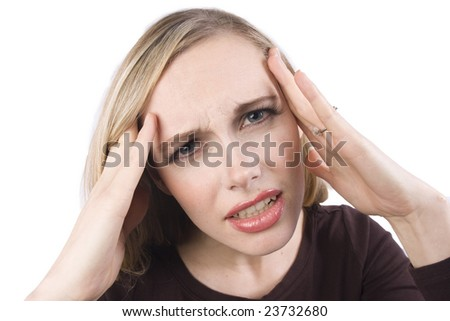 A stressed out girl suffers through a headache - stock photo
