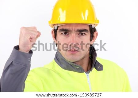 A striking tradesman - stock photo