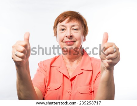 A strong image of a very stress and angry senior woman screaming and clenching her fists.. - stock photo