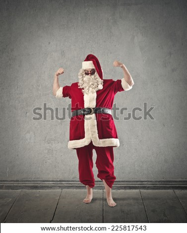 A strong Santa Claus - stock photo