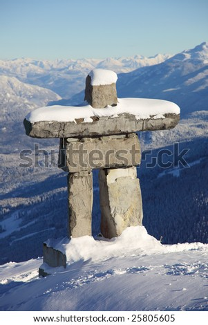 A structure similar to an inuksuk but meant to represent a human figure, called an inunnguaq is a traditional native sculpture. - stock photo