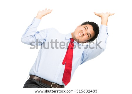 A struggling hispanic office worker in business clothes using arms pushing up, resisting against crushing weight, object under heavy stress, feeling pressure. Isolated on white background - stock photo