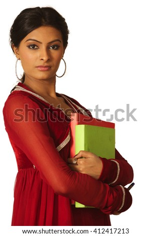 A student holding a pen and the books - stock photo