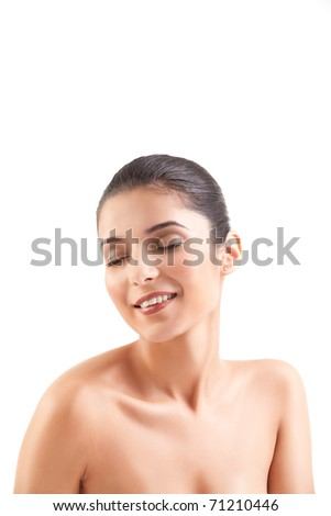 a studio beauty shot of a beautiful woman, with naked shoulders, on white background. her head is turned to the side, her eyes are shut and she is smiling. - stock photo