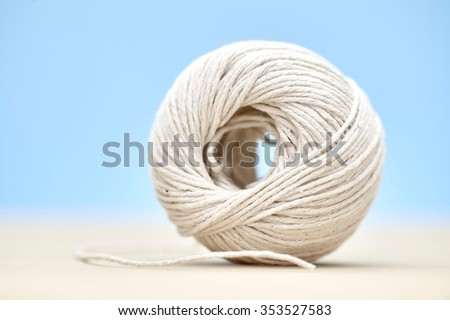 A studio photo of a ball of twine - stock photo