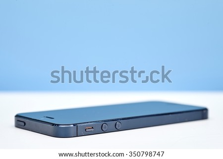 A studio photo of a cell phone - stock photo