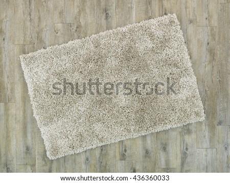 A studio photo of a rug on a vinyl floor - stock photo