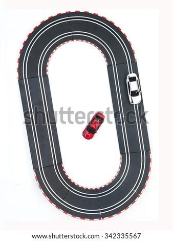 A studio photo of a slot car race set - stock photo