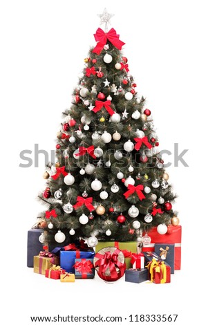 A studio shot of a decorated Christmas tree and gift boxes isolated on white background - stock photo