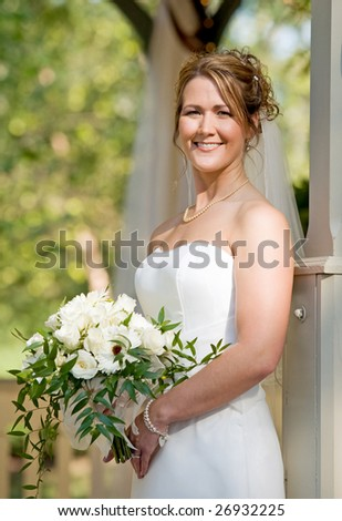 A Stunning Bride Holding a Beautiful Bouquet - stock photo