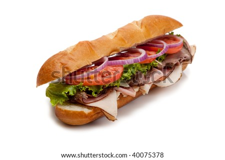 A submarine sandwich including ham, turkey, roast beef, tomato, lettuce, onion and cheese on a french bun on a white background - stock photo