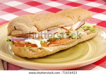 A submarine sandwich on a multigrain bun - stock photo