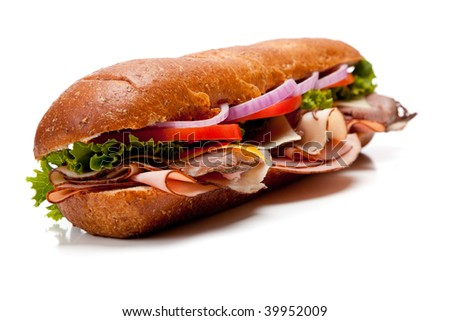 A submarine sandwich with ham, turkey, roast beef, bacon, lettuce, tomato, cheese and onion on a white background - stock photo