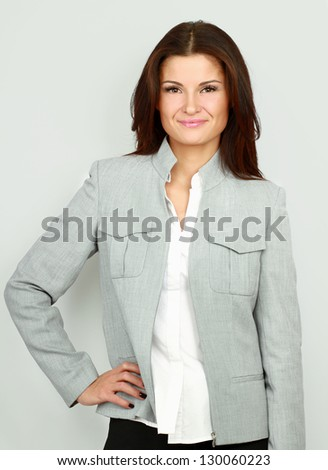 A successful young businesswoman, isolated on white background - stock photo