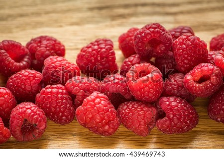 A summer treat the raspberry is a fruit of a multitude of plant species in the genus Rubus of the rose family, most of which are in the subgenus Idaeobatus; the name also applies to the plants.  - stock photo