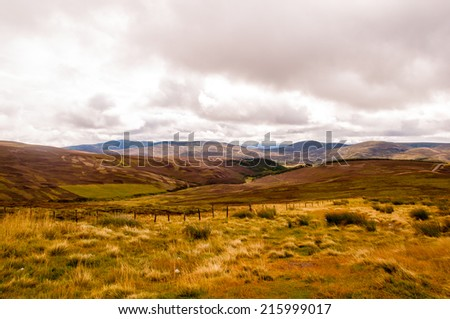 a sunny day in the scottish highlands - stock photo
