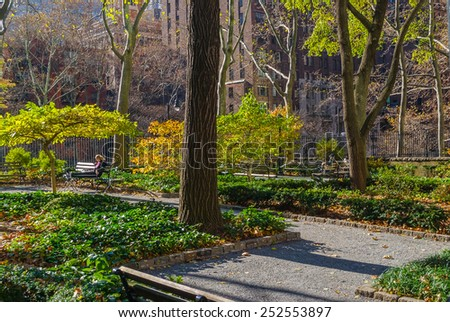 A sunny Fall day in Tudor City Greens, a small park on the East Side of Manhattan. - stock photo