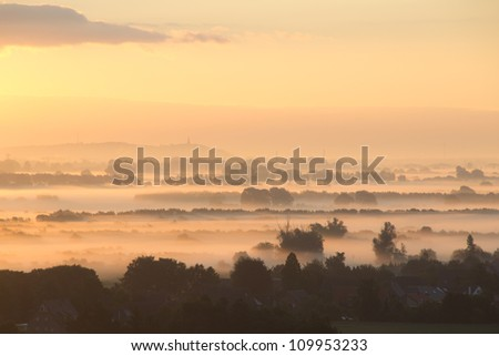 A sunrise above the fog in the Netherlands. - stock photo