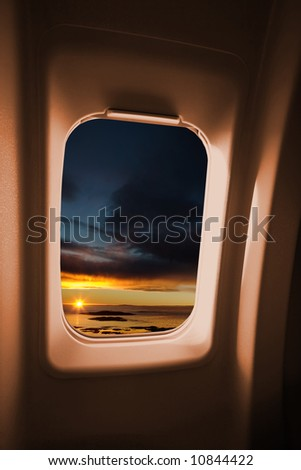 A sunset landscape from an airplane window. - stock photo