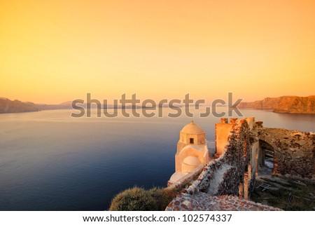 A sunset over Santorini island, Greece - stock photo