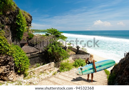 A surfer overlooking  a beach in Bali - stock photo