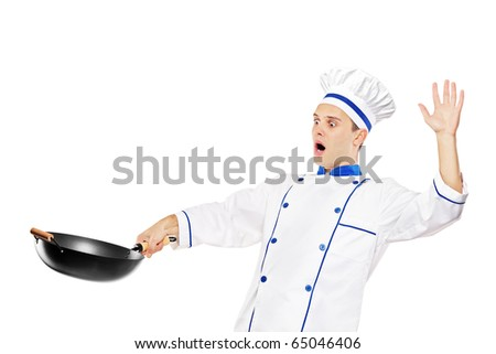 A surprised chef holding a wok isolated against white background - stock photo